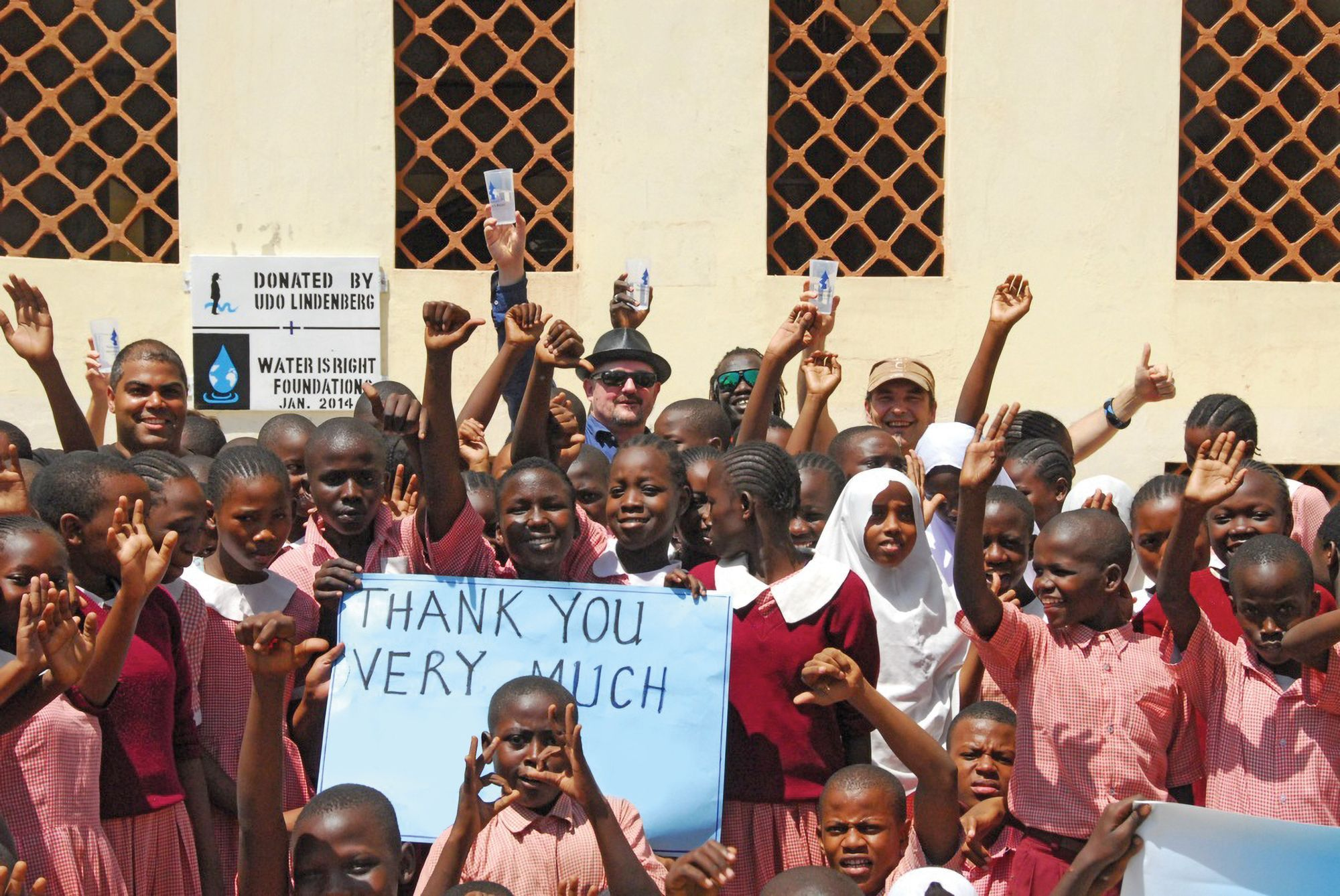 Rolf Stahlhofen, founder of the Water is Right foundation, with children in Africa. Picture: Water is Right Foundation